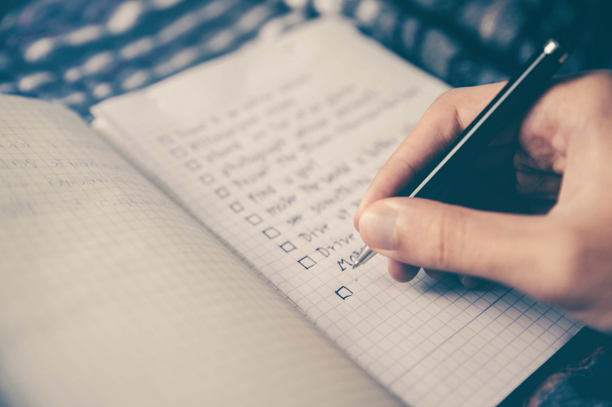 Person marking a checklist