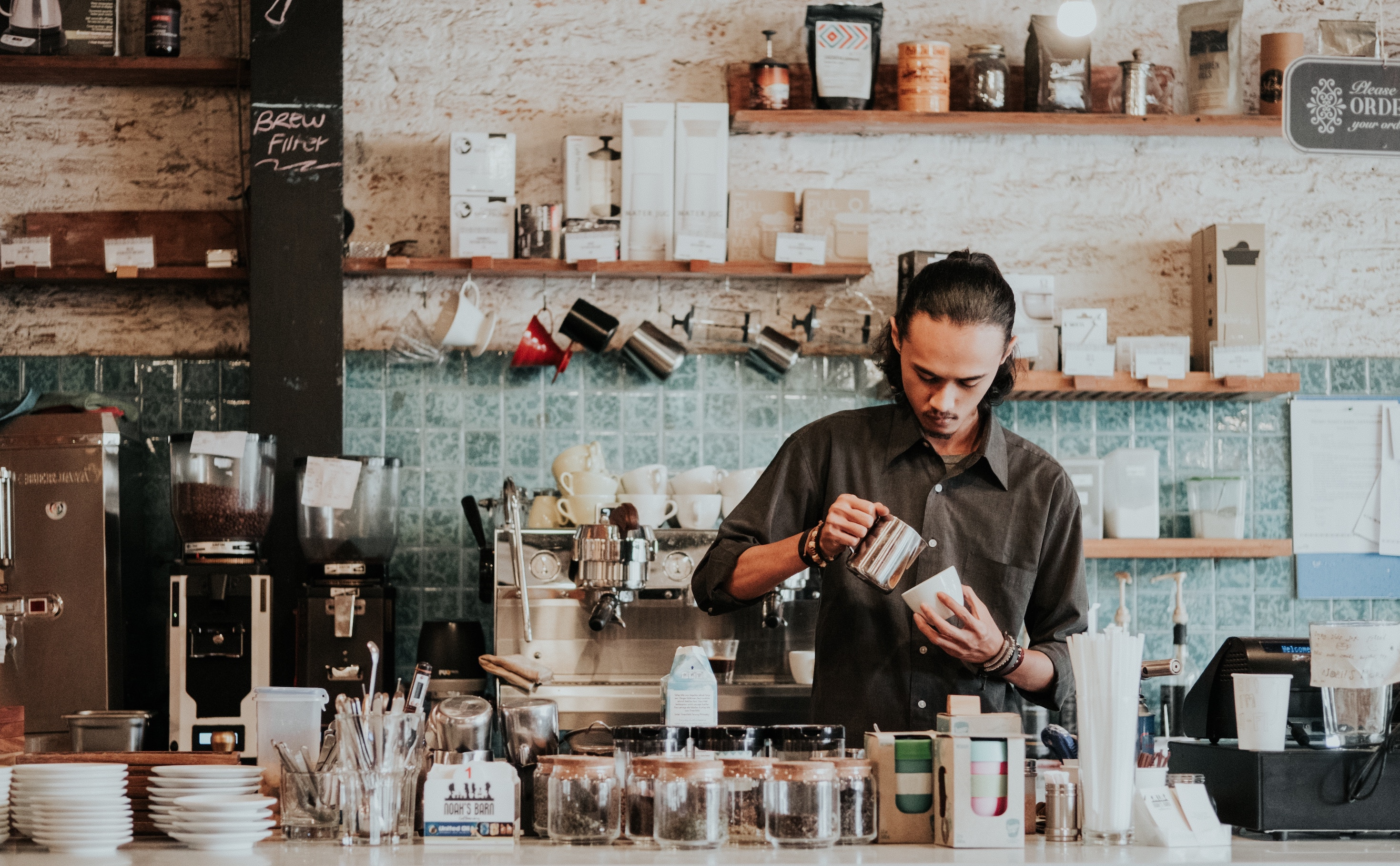 Man in a coffee shop making coffee